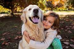 Little girl embracing her dog Royalty Free Stock Photos