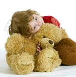The little girl embracing plush toys. Royalty Free Stock Photo