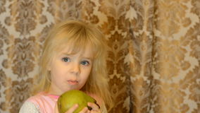 Little Girl Emotionally Taking a Bite out of a Fresh, Organic Pear stock video