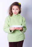 Little girl with empty dish Stock Images