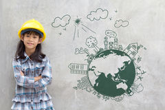 Little girl engineering with creative drawing environment. With happy family, eco friendly, save energy, against a brick wall royalty free stock photo