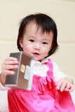 Little girl enjoy with iron cans Stock Photos