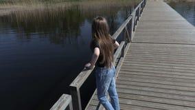 Little girl enjoy nature on floating bridge. Stock footage video stock video footage