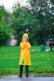 Little girl enjoy the rain on warm autumn day Royalty Free Stock Photography