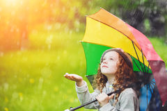 Little girl enjoy to spring rain. Little curly girl enjoy to spring rain stock photography