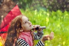 Little girl enjoy to spring rain. Cute little girl enjoy to spring rain stock image