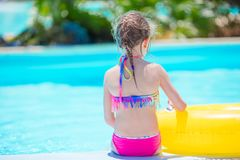 Little active adorable girl in outdoor swimming pool ready to swim Royalty Free Stock Images