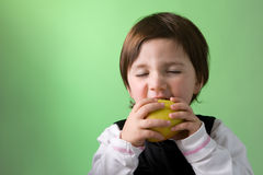 Little girl enjoying apple Royalty Free Stock Image