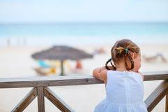 Little girl enjoying beach view Stock Image