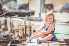 Little girl enjoying beautiful day near city harbor Stock Photography