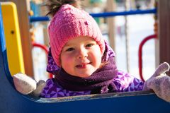 Little girl enjoying beautiful winter day outdoors stock photos