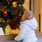 Little girl enjoying christmas shopping Royalty Free Stock Photo