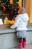 Little girl enjoying christmas shopping Royalty Free Stock Images