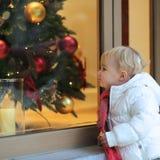 Little girl enjoying christmas shopping Royalty Free Stock Image
