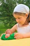 Little girl enjoying Easter time Stock Images