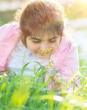 Little girl enjoying flowers Royalty Free Stock Image