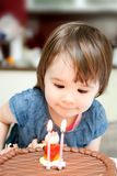 Little girl enjoying her birthday cake. An adorable little girl enjoying her birthday cake Royalty Free Stock Images