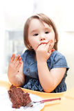 Little girl enjoying her birthday cake. Stock Images