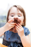 Little girl enjoying her birthday cake. Stock Photo