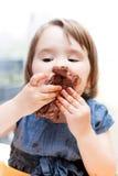 Little girl enjoying her birthday cake. An adorable little girl enjoying her birthday cake Stock Photo
