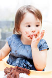 Little girl enjoying her birthday cake. Royalty Free Stock Image