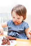Little girl enjoying her birthday cake. Stock Photography