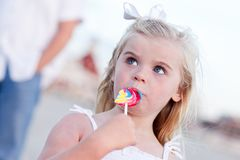 Little Girl Enjoying Her Lollipop Royalty Free Stock Photography