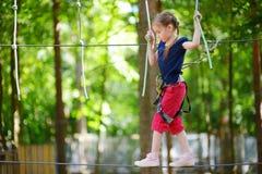 Little girl enjoying her time in adventure park Stock Images