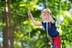 Little girl enjoying her time in adventure park Stock Photography