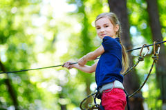 Little girl enjoying her time in adventure park Royalty Free Stock Images