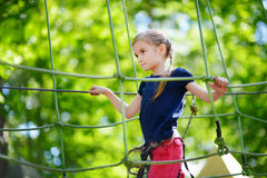 Little girl enjoying her time in adventure park Royalty Free Stock Image
