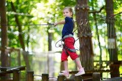 Little girl enjoying her time in adventure park Stock Photo