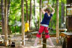 Little girl enjoying her time in adventure park Stock Photos