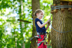 Little girl enjoying her time in adventure park Royalty Free Stock Photos