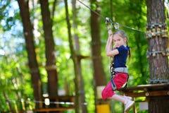 Little girl enjoying her time in adventure park Stock Image