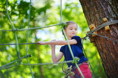 Little girl enjoying her time in adventure park Stock Photography
