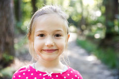 Little girl enjoying a hike through the woods Royalty Free Stock Photos