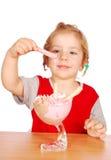 Little girl enjoying ice cream Stock Images