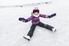 Little girl enjoying ice skating in winter season Royalty Free Stock Images