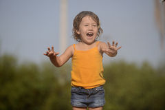 Little girl enjoying the light summer rain. Royalty Free Stock Photos