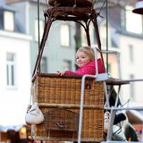Little girl enjoying merry-go-round Royalty Free Stock Photos