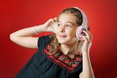 Little girl enjoying music Stock Image