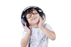 Little Girl Enjoying Music in Headphones Stock Image