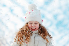 Little girl enjoying nature on a winter walk Stock Images