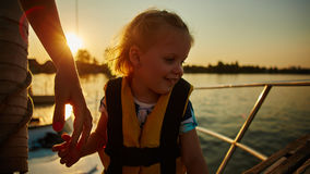 Little girl enjoying ride on yacht Stock Photo