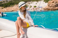 Little girl enjoying sailing on boat in the open Stock Photos