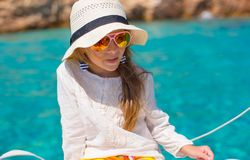Little girl enjoying sailing on boat in the open Stock Image