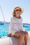 Little girl enjoying sailing on boat in the open Stock Photography
