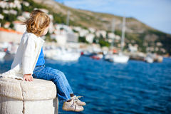 Little girl enjoying sea view Stock Image