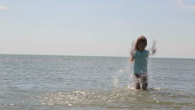 A little girl is enjoying sea water stock video